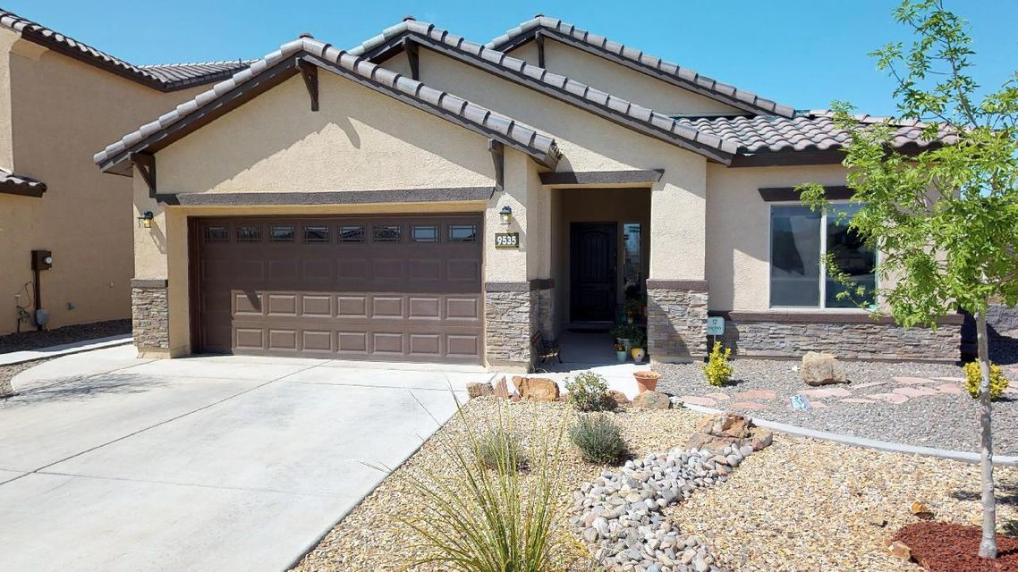 Gorgeous Home on a Corner Lot in the Boulders. Build Green NM-Silver Certified. OPEN FLOOR PLAN, Wood Look Tile & Laminate Flooring, Gourmet Kitchen, Huge Granite Island w/ Bar Seating, Recessed Lighting, Dark Birch Cabinets w/ staggered Uppers, Granite Countertops, Glass Tile Backsplash, SS Appliances, Built-in Oven & Microwave and Separate Gas Range Top, REFRIGERATED COOLING, Tankless WH, 9 foot Ceilings thru-out. Brushed Nickel Hdwe. Large Master Suite, separate from Secondary Bedrooms for Privacy. Luxurious Master Bath w/ separate Tub & Frameless Glass Shower.  Enjoy the Private Walled, Professionally Landscaped Backyard from your Nice Covered Patio, Grass, Propane Firepit and Seating Area. Oversized 2.5 Car Garage (Could be Bedroom 4) Backyard Access Possible. MOVE IN READY!