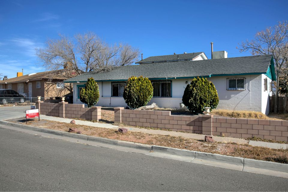 What a great opportunity for any buyer! This two story home located in the SW of Albuquerque features amazing views of the city. Upgraded kitchen featuring new cabinets, counter tops and tile in kitchen. Two master bedrooms. Upstairs master has a his and her closet. Two living areas one that features a wood burning fire place. This home features a fifth possible bedroom or office space also with a detached one car garage. Now is the chance to make this home yours!