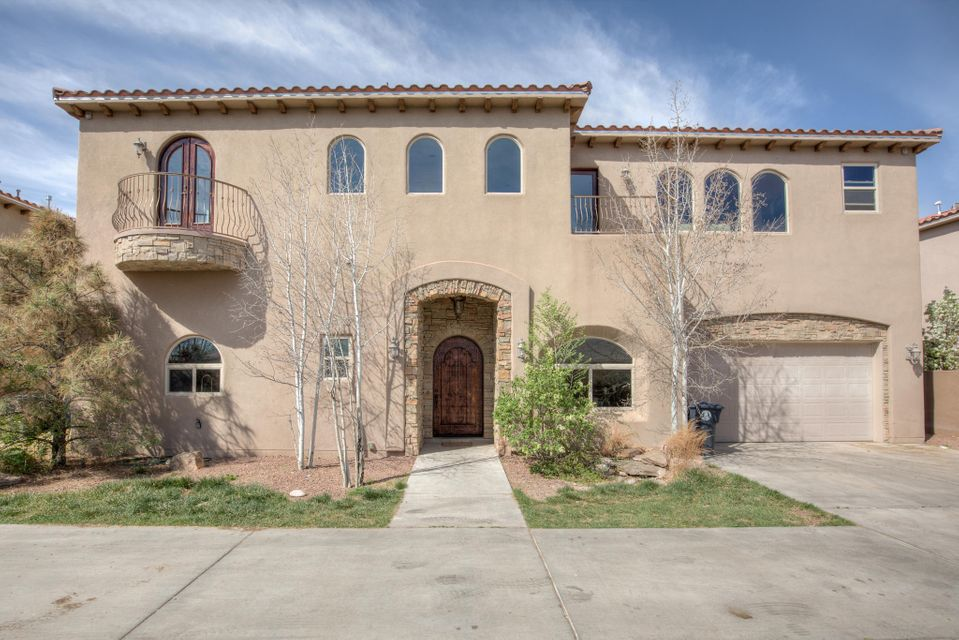 Welcome to this striking Tuscan-style home nestled in the North Valley right off of Rio Grande. From the moment you walk in, the soaring ceilings and flooding light will brighten your day.  You will immediately notice the spectacular finishes including diamond plaster, Alderwood cabinets, travertine flooring, custom stone and tile work.  The diverse floor plan offers multiple living areas and a study/office, plus a kitchen to impress the best of chefs. Step your way upstairs through a royal staircase to a master suite with a spa-like bath and a large soaking tub to relax in. With a low-maintenance yard and quick access to 1-40, this is the place you've been waiting for. Call for your private showing today.
