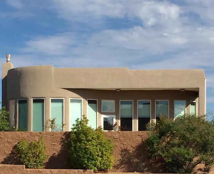 Amazing ''Scott Patrick'' home in the much desired ''Andalucia De La Luz'' community, located near the beautiful Bosque in Northwest Albuquerque. Contemporary Southwest design.  walking trails, close to new shopping center. Great Room includes a curved window wall that give it a bright and open look throughout. Kitchen includes a center island, granite counter tops, custom maple cabinets, skylights, recessed lighting, stainless steel appliances and ceramic tile. The spacious outdoor patio is a must for entertaining and enjoy watching the fireworks from Balloon Fiesta Park  with a built in gas grill and beautiful view. Low maintenance landscaping and other amenities make this home a must see. Close to Freeway and Schools. Community Park nearby.