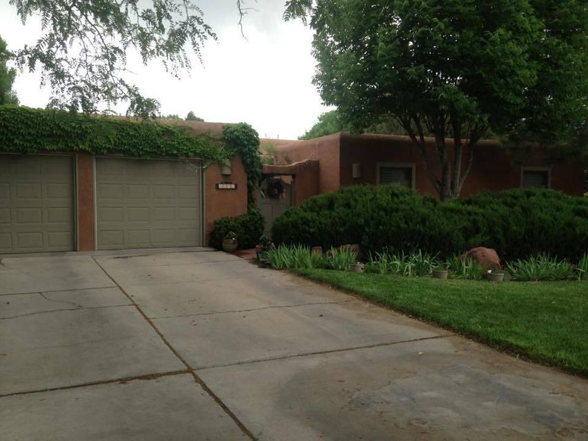 This is a wonderful near-north valley find in Thomas Village.  Large park-like lot with wonderful outdoor living spaces, lots of grass and trees.  Close to the Bosque, ditch for walking, Old Town,  museums, and restaurants.  Easy access to I-40 (then I-25).  Southwestern flavor with two Kiva fireplaces, beams, and a courtyard entry.  This house has it all.  Large master suite and bath with  a Kiva and access to the backyard.  The other three bedrooms are spacious and well situated.  One might be perfect as a study if the owner only needs three bedrooms. The large family room opens into the remodeled kitchen as well as to the outdoor spaces. The large backyard has two covered patios, a fountain, paths and planting beds, as well as access for yard work or construction. A visit will sell you!