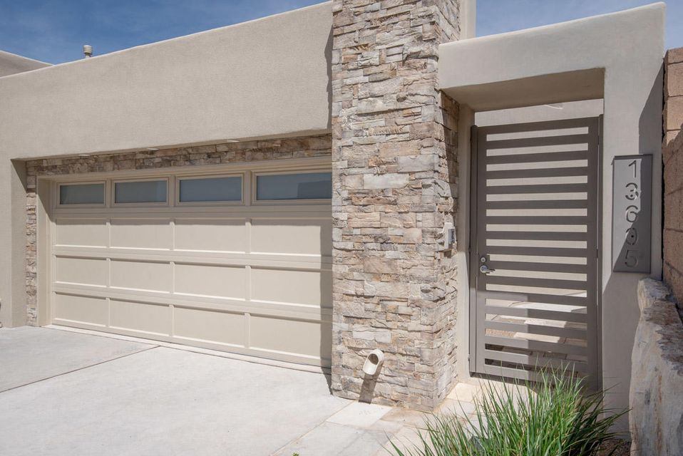BRAND NEW CUSTOM SCOTT PATRICK HOME located in the Wilderness Canon subdivision in High Desert.  Canon is a gated community situated on one of the highest points in High Desert.  This custom contemporary home includes our Scott Patrick features some of which are, granite kitchen countertops, zero clearance contemporary gas fireplace, skylights, large low E dual pane vinyl frame windows, alarm system pre-wire, wood kitchen cabinets and stain color, front yard landscaping with sprinkler system and timer, kitchen aid stainless steel appliances including a double oven, microwave, 36'' 5 burner cook top, dishwasher, and range hood. This home has a covered front porch and rear covered patio with panoramic views of the surrounding area. Under construction additional items could increase price.