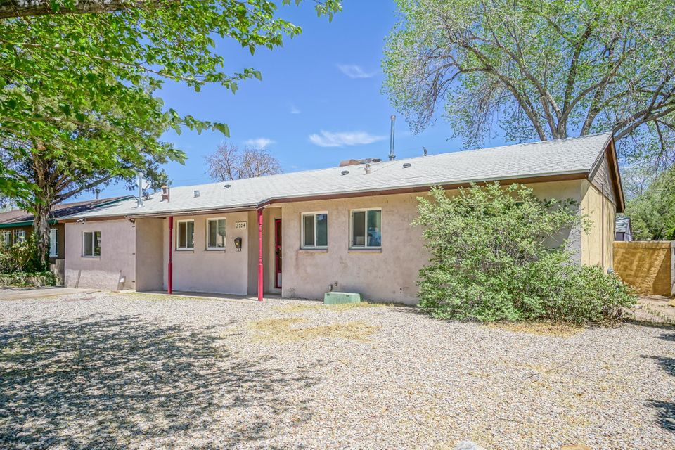 Located in an established NE Heights neighborhood, close to Coronado and Uptown Malls, this ranch style home has been expertly maintained by the owners.  In 2012 the windows were replaced with double paned windows and there is ceramic tile in the high traffic areas.  The bonus room can serve as an office, craft room or 4th bedroom without losing the large living areas.  The back den enjoys a wood burning fireplace before stepping out into the backyard.  And oh what potential in the backyard!  With sprinklers feeding the bottom area, there's even a storage shed to house your landscaping tools!