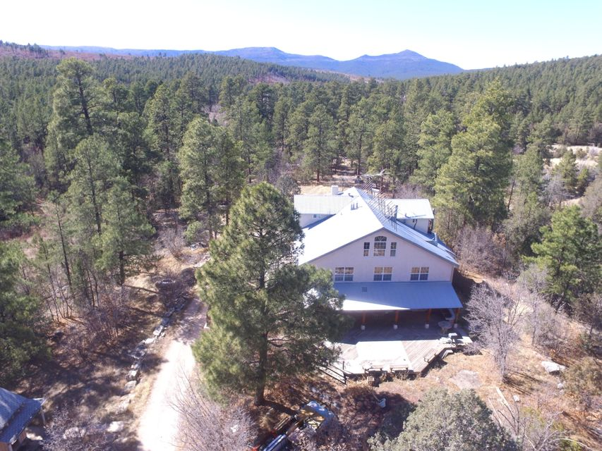 Extensive mountain property with approximately 60 plus acres, 3 wells, 1 spring, 2 streams, multiple structures. Main house is 6223sqf with 6 bedrooms and 5 bathrooms. Detached cabin is 637sqft. Duplex with 1 bedroom, kitchen and 3/4 bath in each unit. 4th building is a barn converted to living quarters. What an opportunity to get into this property with a little TLC and have your own mountain compound. Endless opportunities with a little TLC. Owner financing and trades considered!