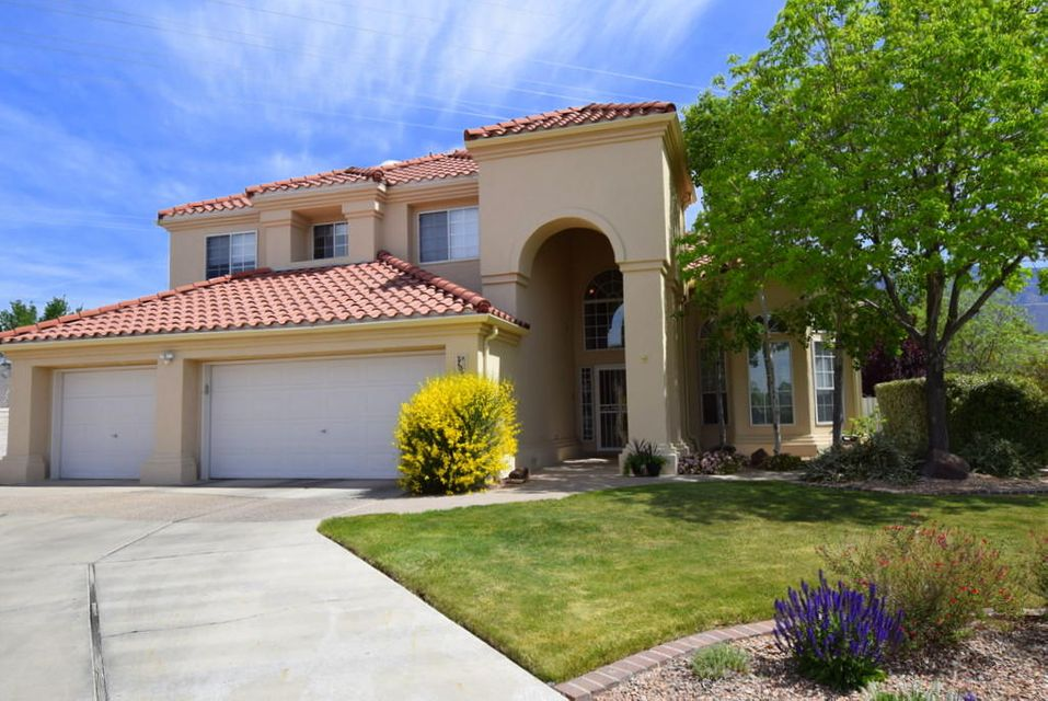 Gorgeous Home in the Estates at Tanoan is walk-in ready. Open the front door to a light and airy home with the Living Room/Dining Room, dramatic staircase, wood floors, walls of windows and outdoor views.  The Large Kitchen has an island, builtin serving buffet with lots of storage, granite counters, updated stainless BOSCH dishwasher and Stainless Kitchen Aid double oven,breakfast nook. FR/wood floors,updated FP,views.The backyard oasis has waterfalls, a pond, raised gardens,outdoor entertaining area, concrete area for kids to play. The first level has 1 BR/wood floors/adjacent full bath. MBR suite with  wood flooring, FP, updated full bath/granite/designed closet.Upper decks/views.3 car garage, work bench,storage. Newer Wood floors, tile, and 1 yr old.synthetic Stucco