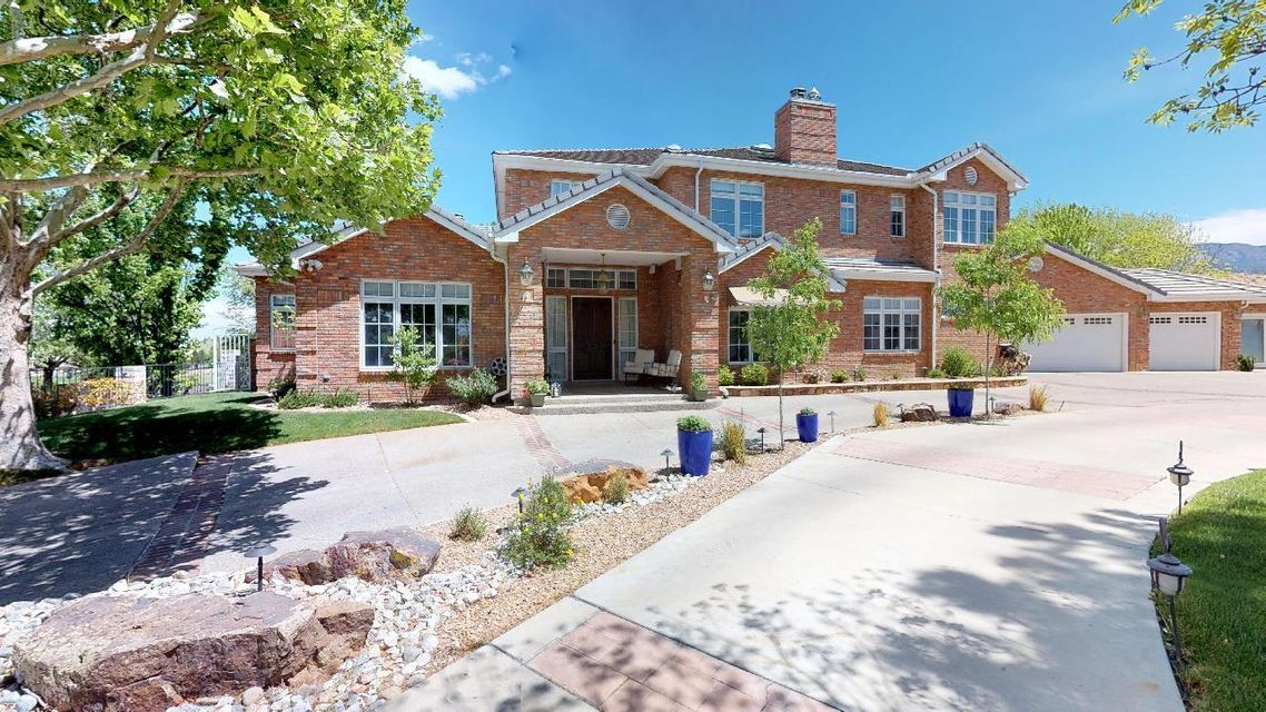 Elegant Luxury Brick Custom Home on Lush Golf Course View lot in Tanoan; Backyard w/Pool/Hottub & Patios overlooking the Lake/Lalique on Tanoan Golf Course; Magnificent Panoramic Mountain, City and Sunset Views! Master Chef's Gourmet Kitchen w/Wolf Gas Range/Dual Ovens & Grill/Convection Oven, Warming Drawer, Prep Sink + 2 Full Sinks, Butler's Pantry;Custom Cabinetry, Mantels & Crown Moulding;Formal Dining Room, Office/Library; Exercise Room w/Sauna or Nursery; Billards/Pub Room w/Wet Bar, Bedroom & 2 Full Bathrooms down; Upstairs Expansive Master Bedroom & Bathroom Retreat w/2 View Balconies; Completely Remodeled! Spacious Master Closet w/Washer/Dryer; Beautiful Hardwood Floors, 2 Bedrooms w/Jack & Jill Bath, 3 Car Garage + Workshop/Golf Cart Storage;6 Fireplaces, Magnificent Retreat!