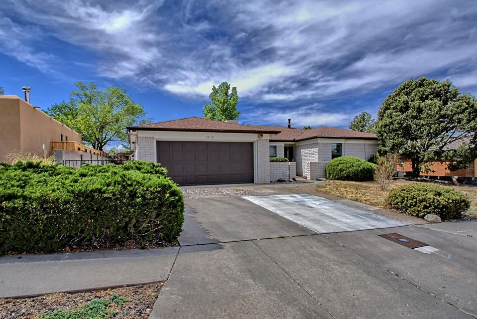 Lovely Kachina Hills home situated oh so close to mountain walking and hiking trails. Out your front door is a close up view of our beautiful Sandias.  Freshly painted throughout May 2018,  New carpet  May 2018.  Roof replaced in 2010, water heater replaced in 2015, Stainless Steel microwave and oven- 2017, newer insulated garage door. Dramatic Floor to ceiling rock fireplace in family room which is open to kitchen area. Great Freshly painted closet spaces in hallways and bedrooms.  Laundry room sports space for a additional refrigerator/freezer.   Wonderful large, private lot (.21 acre) with plenty of room for gardening, trampolines, BB Courts etc.  Large trees and large shed.   Come home to relaxation in hot tub room built as an addition to master bedroom. Great Schools & close to park.