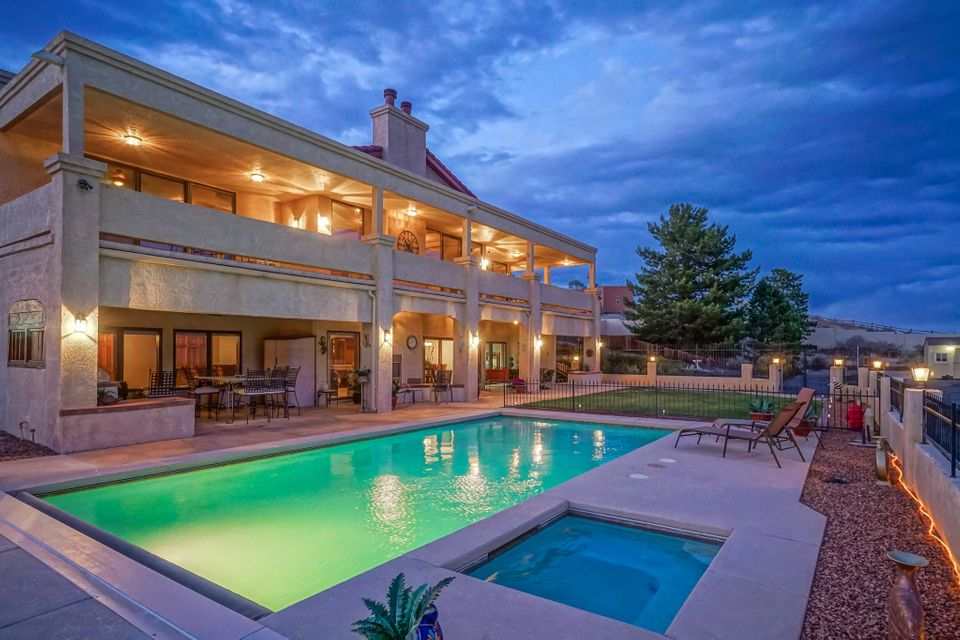 This spectacular home was built by a general contractor to be his own home. Every detail of construction is top quality! From the deck you can see all the way to Santa Fe and Los Lunas, not to mention the stunning view of the Sandias from every east facing window or door!  Need a shop or extra garage?  This shop is 40'x75' with a loft inside and a bathroom. The owners  just spent $20,000 to resurface the asphalt driveway/entry for the new owners! RV hookups and dump. Playhouse with electrical.  Basketball court! Sale includes 2 parcels for a total of 2.1 acres. You'll have to see it to believe how wonderful this home is!