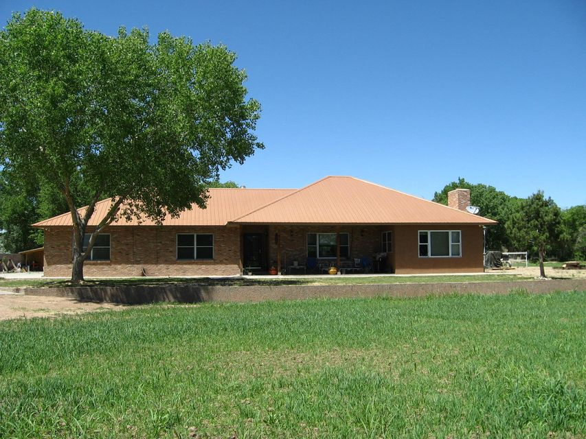 Beautiful recently renovated home with hardwood floors in bedrooms and laminated and tile flooring through out the rest of the home. New paint through out.  Beautiful copper-colored metal roof.  Nice horse property with 7.43 total acres and approximately 6 acres of recently seeded alfalfa.  Pipe fence for your horses and other livestock. Formal dining room or living room in the front and separate family room with fireplace. Large bedrooms. Don't miss out on this property.