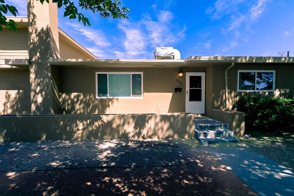 This impressive UNM area remodel boasts sophisticated updates throughout. One of the larger homes in the immediate area, the 4 bed, 2.75 bath remodel includes a chef's kitchen w/ hardwood cabinets, black granite, stainless appliances, and contemporary tile (installed 2018). Ground floor with beautiful oak floors. Upstairs master suite w/ views has elegant en suite master bath w/ double vanities, luxurious tub & separate shower. Additional features & updates include remodeled bathrooms, recent carpet, French doors installed 2018, upstairs addition siding installed 2017, thermal windows, recessed lighting, & handsome kiva fireplace. Mini-splits cool/heat master suite addition & den. This sunlit, comfortable home is nestled in a desirable neighborhood, close to Nob Hill, UNM, & midtown.