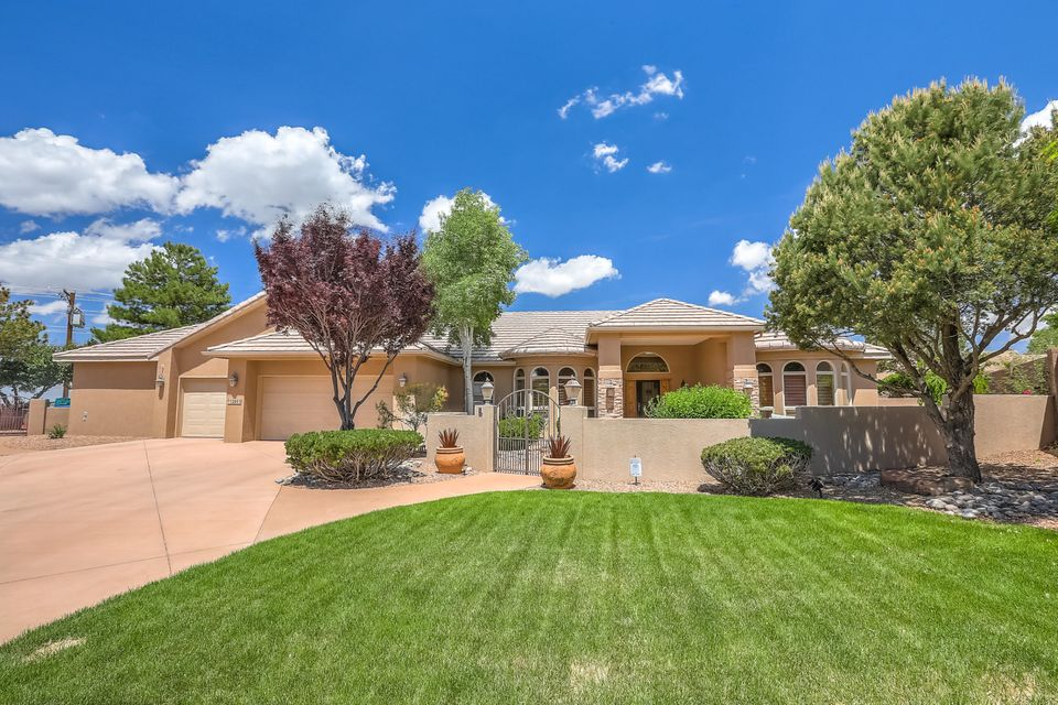 Well-designed Rutledge custom single story home is offered for sale in High Desert. You are greeted with a front courtyard for enjoying a view of the foothills.The spacious floor plan offers 4 bedrooms, 2 large living areas, formal dining, and large master suite. The large master offers walk in closets, double vanity, jetted tub, and room that could be a gym, office, or nursery. The expanded 3 car garage gives you space for a work shop and plenty of parking. The beautiful backyard entices you to entertain under a covered patio with a fire place, water feature, professional landscaping, gardening area and the beautiful city lights. The home and floors throughout are warmed by radiant heat and cools with refrigerated air.  This home is ideally located and in the Eldorado high district.