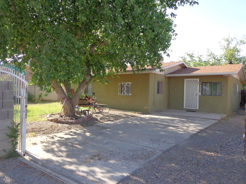 This Wonderful Home in the Heart of the South Valley Features 2 Bedrooms with an Office Study. Ceramic Tile Kitchen and Dining area, Huge Laundry Room. There is a 365 Sq Ft Possible Mother in Law Quarters it has been dry walled Air Conditioner added and has plumbing for a full bathroom and kitchen area. Or you can simply use it for storage.