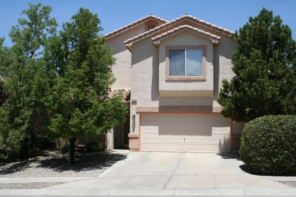 Move in ready! Spacious, open floorplan in the La Cueva District.  Two living areas, formal dining room, loft for recreation/TV/exercise room or possible 4BR.  MBR suite is made for royalty! Mountain views from balcony.  Shopping, Domingo Baca Parks and schools just a few blocks away. Real Estate Contract Possible too.