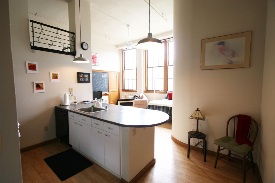 Approximately 506 square feet, this loft is located in the historic 1935-built Classroom building at The Lofts at Albuquerque High. The loft features an island kitchen (with refrigerator, oven/range, microwave, dishwasher), full bath, original wood floors, original oak window trim/sashes, 14-foot-tall ceilings, 3 east-facing operable windows with views of the courtyard, and original chalkboard. Laundry and elevator in building; access to laundry/exercise room in Old Main building. Access to beautifully landscaped secure courtyard with grill, fountains and seating.  Condo Association Fee $190/month (covers water/sewage/trash/recycling, insurance, common area maintenance, cash reserves contribution). Parking:  Free on-street parking, or park in City-owned garage at 100 Arno for $40/month.