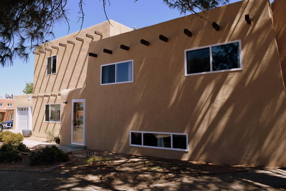 This home has amazing updates!  Kitchen features new cabinets, new appliances, gorgeous granite countertops!  Bathrooms beautifully updated. Throughout the home all new flooring, lighting, doors are solid wood inside & metal exterior. 3 New heating & refrigerated air units! New windows, stucco, garage doors, gutters, updated electrical, tankless water heater, upgraded insulation. Split level home. Lower level: huge living room, heat generating fireplace, hobby or 5th bed,3/4 bath & utility, back yard access. Main level: features kitchen, living & dining areas, lovely french doors to the large covered patio.  First upper level: 3 spacious bedrooms, full bath & custom paint.  Upper most level: Private Master Suite, full bath, storage.  Mature landscape, 2 car attached garage, great location.