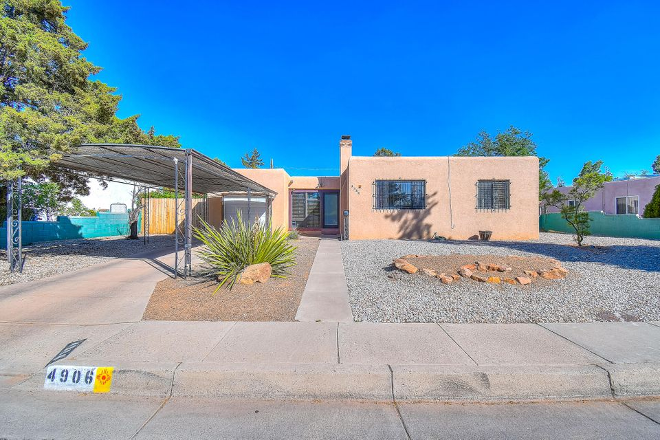 Beautiful wood floors, upgraded base boards floorplan open and bright, Updated Bathroom and Kitchen Counter Tops. Great size lot just shy of a quarter acre. Located in the desired  Ridgecrest area. Very close to Nob Hill services, UNM, Base, Hospitals...amazing opportunity! You don't want to miss out!