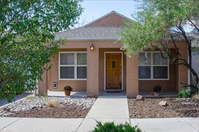 You don't want to miss this adorable Downtown gem! This home has cathedral ceilings with tons of natural light from large updated windows and skylights. The gas fireplace compliments the open layout and built-in shelves! The backyard has been xeriscaped, making it ideal for entertaining and is low maintenance!