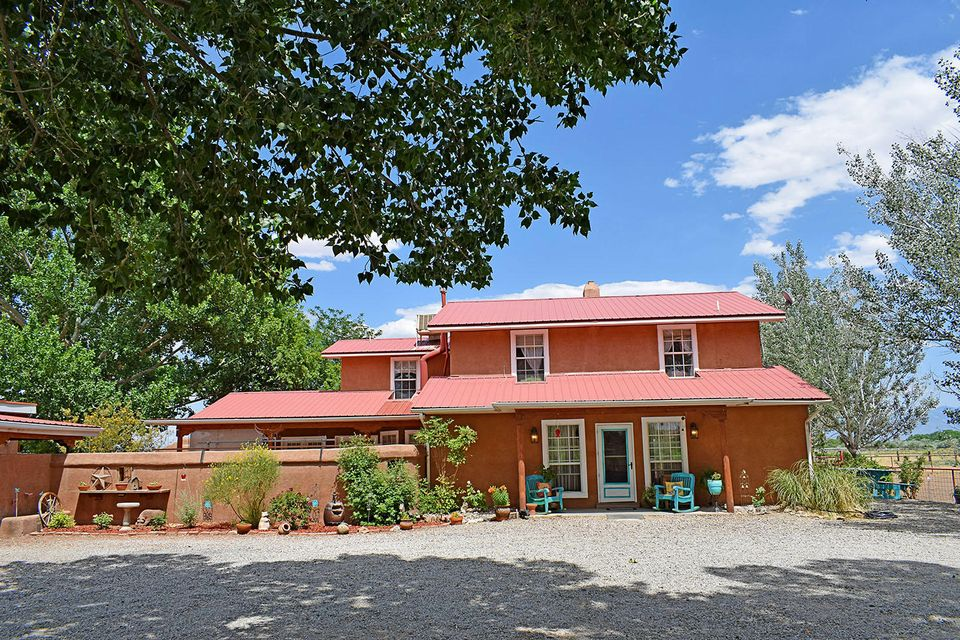 Northern NM. style, 3 bedroom House on 5.8 ac. is stunning,  beautiful brick floors,surrounded by beautiful views,of the Sandias and Manzanos. Trees, apple orchard, pipe fenced,330 sqft.tack room,storage, perfect for the horse enthusiast Minutes to Railrunner.