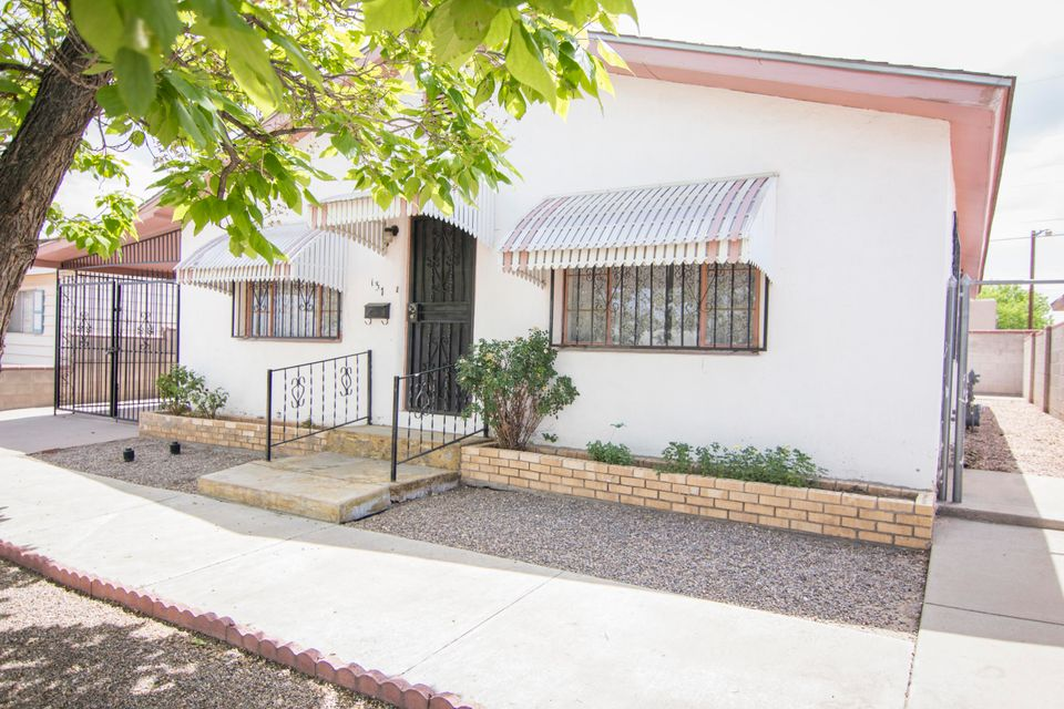 This home is full of original adobe charm! This 3 bedroom 2 bathroom home has incredible view of the Sandia Mountains. The single car garage has a loft space above it and plenty of attic storage space. This home is easy access to Central  and has perfect space for entertaining!