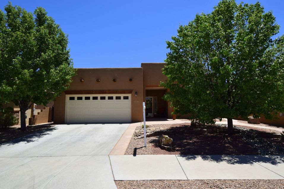 Stunning home with southwest accents & spectacular Sandia Mountain views. Home backs to the Bosque Preserve for added peace & tranquility. One of a kind home in active adult community by Del Webb. Impressive kitchen with SS appliances, granite counters, maple cabinets, large center island & walk-in pantry. Great room boasts tongue & groove ceiling with vigas and custom designed gas fireplace with hearth.  Wired for surround sound.  Dazzling bathrooms with granite countertops & tile accents. Owner's suite has a generous walk-in closet & spa bathroom with jetted tub, double sinks & walk-in shower.  Tremendous garage storage.  Private & beautifully landscaped backyard with custom fireplace, built-in grill & water feature.  This backyard space is simply spectacular & quite magical!