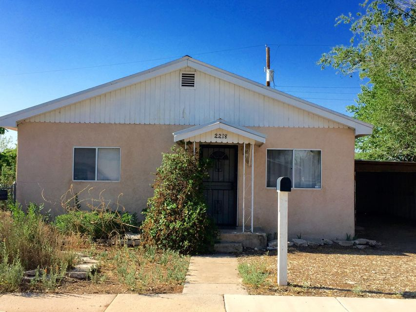 Great Home on a ''Double-Sized Lot'' just off Rio Grande Blvd.... and  on a cul-de-sac.  Close to Old Town, the river, Nature Center, I-40... and so much more! House includes: 2 Master Bedrooms with large walk-in closets and siting rooms, 1 Full Bath,  great room and updated kitchen, all under a metal roof. 1-Car Garage (or great workshop) + Carport. Remember the double-sized lot - fully fenced with fruit trees, raised-bed garden... plus room for a lot more. Back/Side-yard access possible. Sold AS-IS!  Seller will not make any repairs.  Hurry... this great opportunity won't last long!
