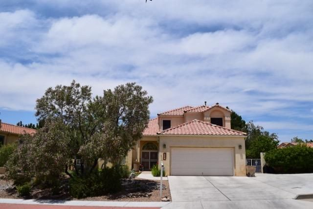 This Beautiful Home Sits on the Base of the Sandia Mountains. Updated Modernized Kitchen Remodled in 2010 with Stainless Steel Appliances with Granite Counter Tops and Tile Back Splash. Pergo and Real Wood Flooring New Furnace and Refrigerated Cooling unit with Dedicated Solar Panel to help with electric costs of Refrigerated Air.  Huge Master Bedroom with Walk in Closets and storage area Double Sinks in master with Sep Shower and Jetted Tub, A 15.3 x 8 Sunroom off of Master Balcony. Beautiful Pond outside in the backyard, Covered Patio and lush landscaping in both the front and backyard with a Garden Area. Built in Speakers and Intercom system in the home. Alarm system may convey. This is a must see home!! updated lighting. $3500.00 Buyers Incentive to buyers closing costs.