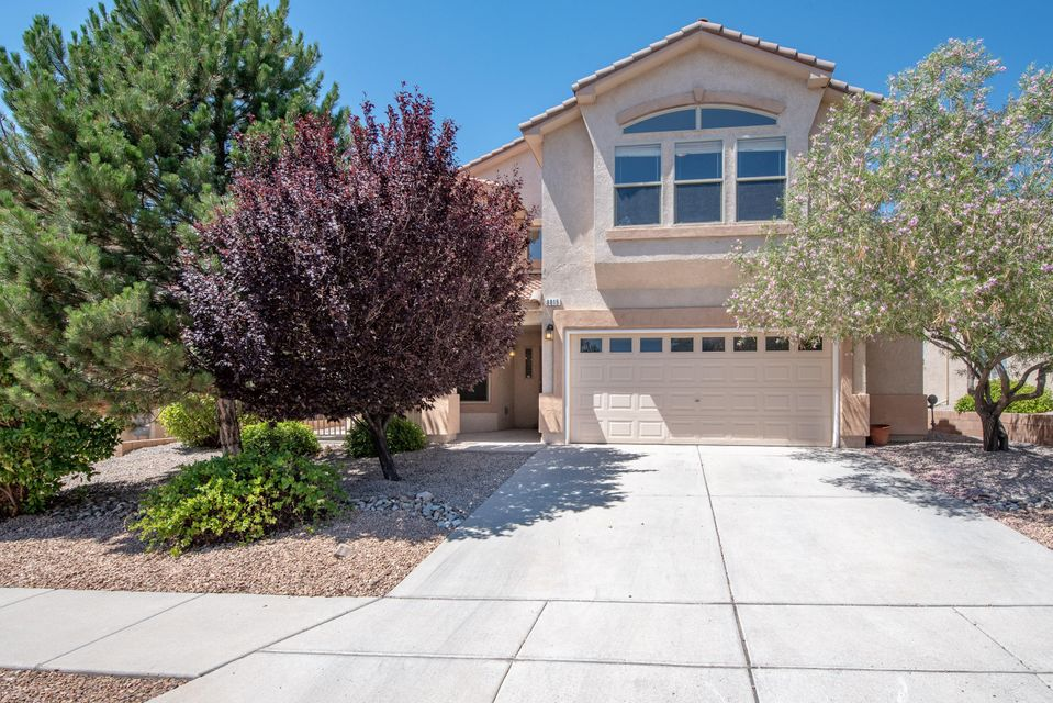 This beautifully remodeled home in the highly desirable Desert Vista neighborhood has three living areas including living room, family room with stacked stone fireplace and large loft. Remodeled kitchen has large pantry, island, breakfast nook and updated cabinets, granite counter tops and mosaic tile back splash. Spacious master suite has walkin closet and bath with new custom tile shower, garden tub and vanity with granite counter tops. Additional updates including new laminate flooring on first floor, new carpet in bedrooms and new tile in baths and laundry room. Home has been freshly painted. Home is a short distance to shopping, dining, La Cueva High School and Desert Ridge Middle School.