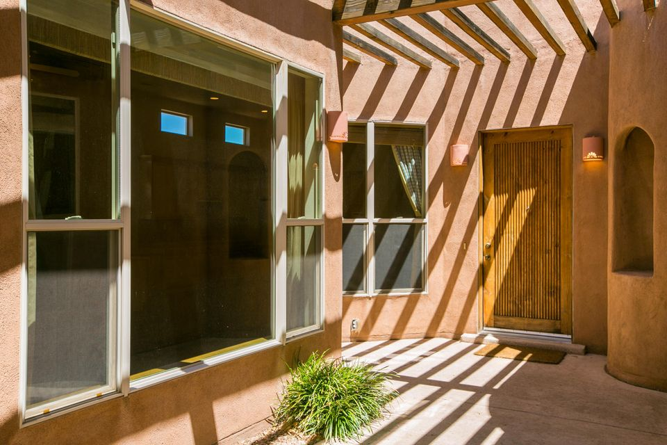 Priced to sell, ready for new owners looking for a gated community in High Desert. This home offers privacy with a welcoming feel as you enter through the courtyard accented with wood vigas and flagstone.The Casita located just off the courtyard will be perfect for a home office, guest space. Entertain comfortably with an open concept between kitchen living casual and formal dining if preferred, 2nd living area gives just the right space to take in some reading or playing games, each living space is equipped with a fireplace for those cooler days. Step out under your covered back patio to take in the view of the sandias while filling the air with the smell of your favorite backyard barbecue cooking.