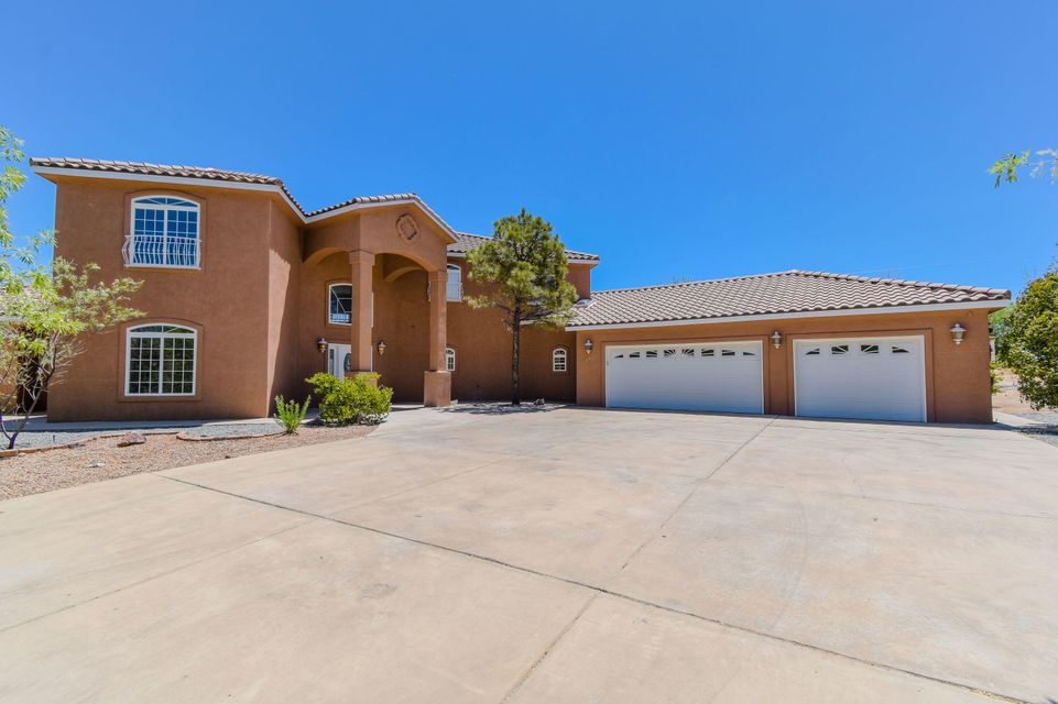 Beautifully remodeled custom home located on a gated 2 acres backing to the Bosque in the Rancho Sereno community! This stunning home features 4,667sf with 4 bedrooms, 3 full baths, 2 half baths, 2 living areas, a loft, guest house and 3 car garage! New paint, carpet, 3 new evap coolers, furnace, water heaters and more! Huge living area with soaring ceilings! Spacious kitchen with brand new stainless steel appliances, ample cabinet space, center island with cooktop, built-in oven, built-in work area and a breakfast nook w/ a built-in china cabinet! Master suite like no other! Spa like bath w/ jetted tub, walk-in shower, custom vanity w/ dual sinks, massive closet w/ separate dressing room and private covered patio! 871SF 1 bed/1bath detached guest house w kitchenette!