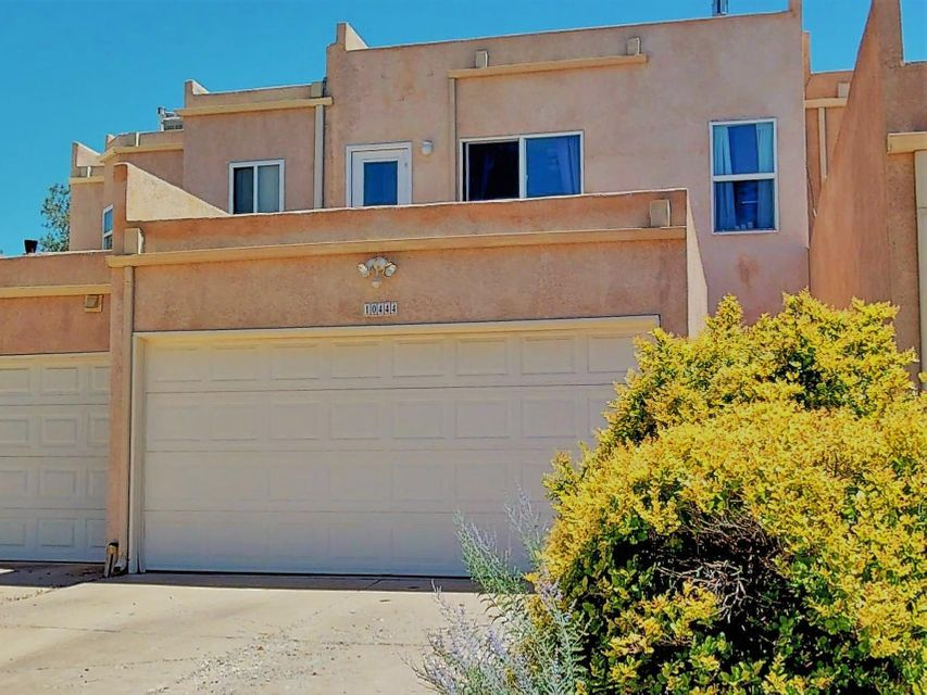 Fantastic NE Heights townhouse in an unbeatable location! Open layout with 3 bedrooms, 2.5 baths and attached 2 car garage. Bright, tiled living areas open onto private patio. Spacious kitchen with lots of storage space. All bedrooms are upstairs and have their own private balconies too! Master suite with its own spa bath and walk in closet. Lots of recent updates! Easy access to CNM, shopping and schools.