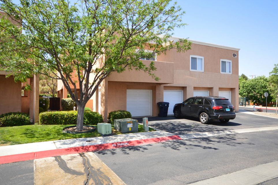 Located in a gated community, this lovely 3 bedroom condo has a bright open floor. Large greatroom has stacked stone gas log fireplace. Kitchen comes complete with stainless gas stove, microwave, dishwasher and refrigerator. Three spacious bedrooms upstairs. Utility room with washer and dryer. Main level has Travertine tile floors and engineered hardwood floors. Home has updated baths and updated light fixtures throughout. Great location near CNM, shopping and dining. Complex has direct gate access to a walking/biking/running trail, Bear Canyon, that ends at the base of the mountain and connects with other trails.