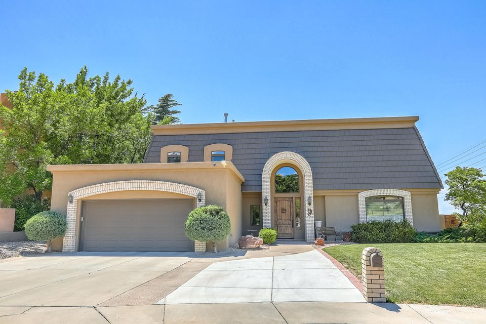 Nestled in a quiet private culdesac this 4050 sq foot is a wonderful family home.  Remodeled gourmet kitchen with exquisite cabinetry is every chefs dream.  Enormous island with top of the line Bosch Appliances.  stainless steel . Sub zero refrigerator. Renewal by Anderson Windows.  Media Room with Surround Sound and Theater Projector Blackout shades in Family room. All you need is popcorn and friends. Generous sized bedrooms and separation of space. Master suite offers a sitting area or make it your office complete with cozy fireplace. Steam shower in master bath.   8 person hot-tub on the large patio is perfect for entertaining.  Refrigerated air and Balcony views. Don' t miss this one of a kind property.