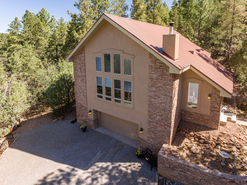 Just imagine pulling up and thinking - We are LIVING the Dream! Nature Lovers/Privacy Lovers Dream come true! This beautiful ONE OWNER, Top Shelf, Crombie home is nestled in the heart of 100's of Ponderosa Pines! Soaring ceilings, master downstairs. massive wooden beams and T&G ceiling; 25 foot vaulted ceiling with panoramic view of forest. On the water system! Property is adjacent to over 300 acres of State owned open space! Additional 1000 sq ft basement NOT included in the sq ft, it stay's the same wonderful temp all year! AND it comes with the most adorable guest cabin you can imagine! Tree house and swing sets, and countless trails to explore God's country! 3 lots make up the 10 acres - see MLS 921201 for the home on 2.5