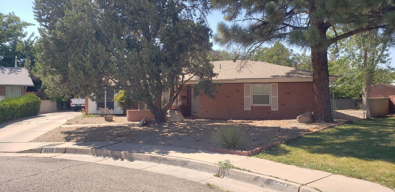 Best location on the block. Private property at the end of the cul de sac. This home has been updated. Two huge living areas. Private patio, and tons of storage. $35,000 Solar system included, have PNM pay you monthly. Home will be available for viewing on Tuesday, June 19th. Call LA for appointment.