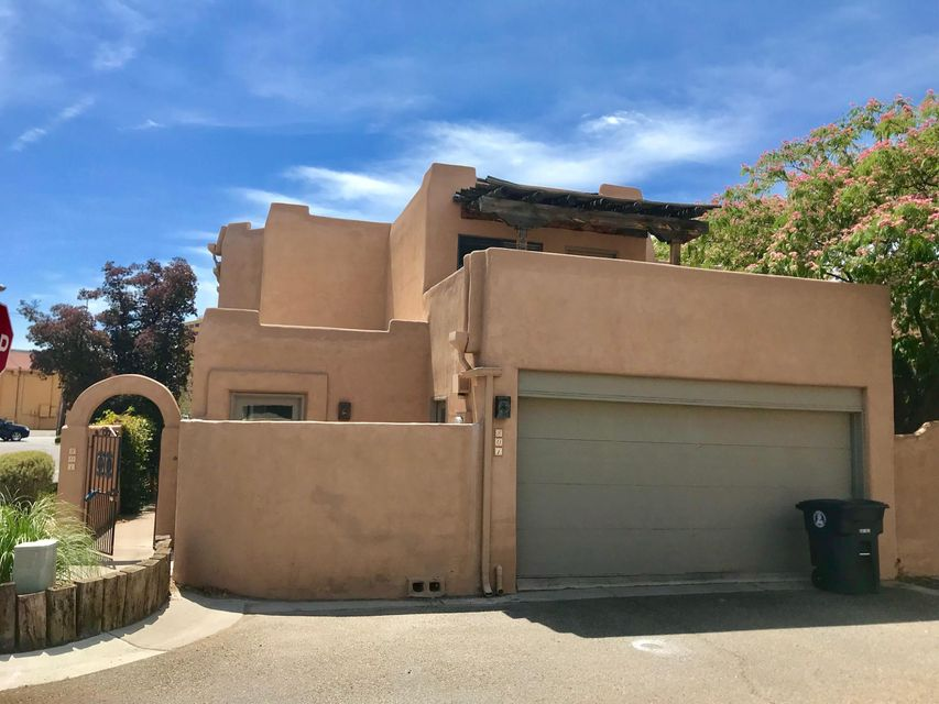 Right in the middle of it all!  This cute townhome is in the heart of the Old Town area.  Surrounded by fun and plenty of shopping!  Easy access to I-40.  This 1800 sq ft, 2 bedroom home has two living areas and wide open spaces! Two patios and one upper walk-out deck allow you to enjoy the dry Albuquerque summer nights.  Kitchen is open and ready for its new owners touch.  Come see this great townhome in a great, established area today!!