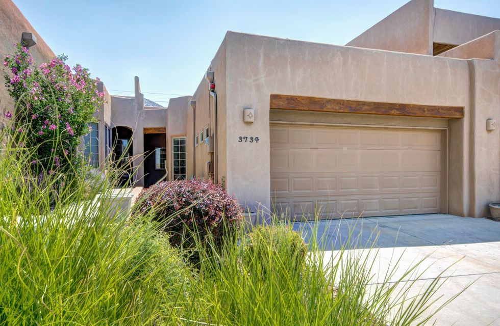 Luxuriously Appointed Foothills Townhouse featuring Pella Aluminum Clad Wood Windows & Doors providing a QUIET atmosphere, an open floorplan w/ 2 nicely Separate & Private Bedrooms, 1.75 Baths & a Large Kitchen to satisfy the Chef in you.  You'll love the Raised Ceilings, Peninsula Fireplace, Built-In Study/Desk, Maple cabinets, Granite Counters, Stainless Appliances.  The Master Suite features a Dual Vanity and Shower plus a Closet any ''clothes horse'' would die for (notice the loft above for seasonal storage).  The second Bedroom features a beautiful built in Murphy Bed.  All of this plus you'll enjoy the Private Patio for fresh air and Sandia Mountain Views.  REFRIGERATED AIR, alarm system, finished garage, washer and dryer, Up/Down Blinds are just the icing on the cake.  NO HOA FEES!
