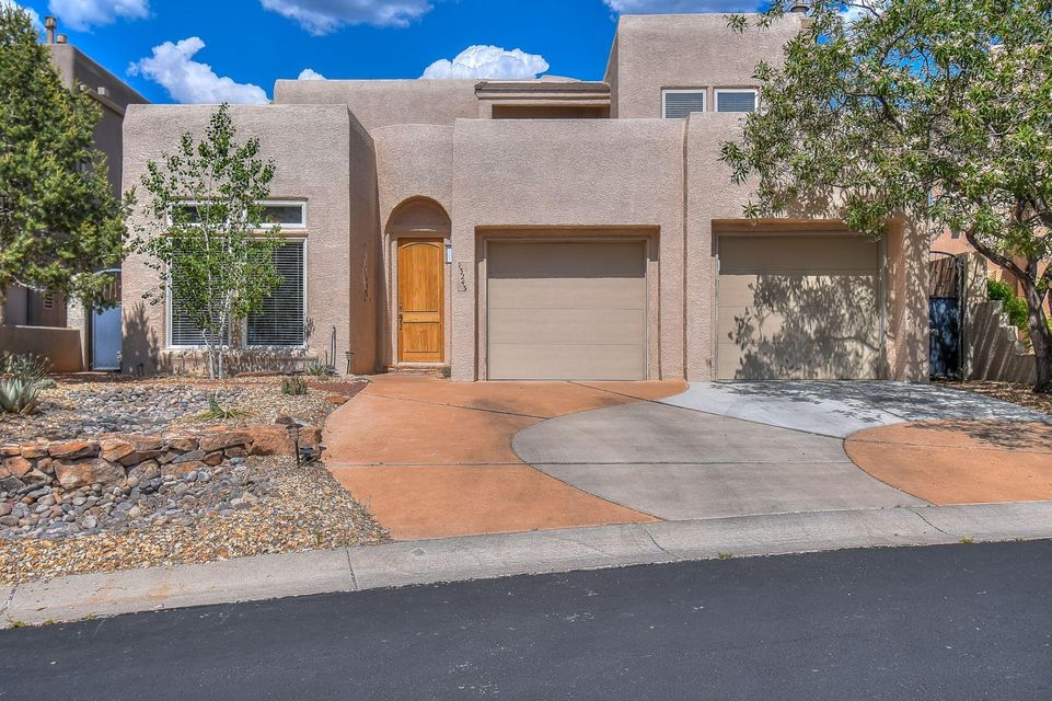 Gated Subdivision in High Desert. Master is on the main level with 2350SF and great Sandia Mountain views. Private hot tub, and Enchanting Waterfall. Built-in wine cooler, stunning mountain views, two outdoor porches. exquisite staircase, 1st floor office or library, 1st floor laundry, programmable PowerView Hunter Douglas blinds, stucco'd exterior wall, modern kitchen, xeroscaped yard.