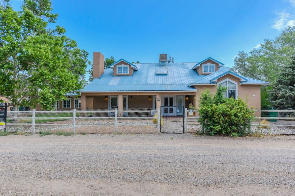 Stunning Custom American Luxury Home located in the heart of the north Valley on a beautiful 1.41 acres in a  Certified Wildlife area! Home features 3,886 sf 3 bedrooms, 5 bathrooms, an office, additional living area, 2 sun rooms & a separate 1087sf casita. 300ft of Commercial land on 4th street for your future business or just to ensure lots of room and privacy.  Spaciously designed eat-in kitchen w/ ample cabinet space, center prep island, built-in oven/microwave, range hood, built-in china cabinet space and skylights! Beautiful living areas with upgraded flooring throughout! 1st floor master w/ a private bath! Bath hosts a vintage fee standing tub and walk-in shower! Outside enjoy the refreshing pool & nights by the fire pit! Casita w/ large living area, updated kitchen, bed & bath