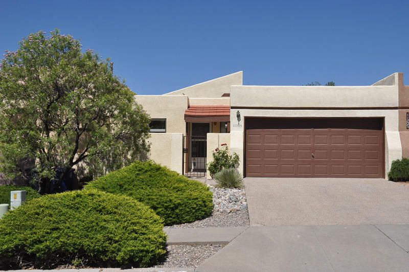 Wonderful open great room floor plan w/7 skylights, 3 clerestory windows and vaulted ceilings* Natural lighting throughout* Walk in the front door & see all the way to the backyard* Views of mountains, sunsets, city lights & mesa* At the end of the block are walking trails* Kitchen has tiled floor; new stainless appliances-5 burner gas range/oven, dishwasher, microwave; new countertops, new kitchen sink & faucet* Carpet 1 year old* Wet bar has new counter, sink & faucet* Recent stucco work & water heater, flat portion of roof approx. 5 years* Wood burning fireplace has gas starter & large mantle* Lots of space for artwork* Guest bath has tile floor and shower over tub* Large master bedroom w/sliding doors to back patio, walk in closet, and 3/4 bath* Xeriscape front & back, turn key & go*