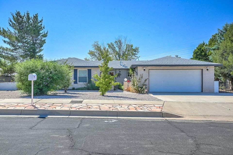 Welcome to this wonderful Cherry Hills Neighborhood home.  Enjoy access to Cherry Hills park right next to your home plus a location that is steps from the public library and walking trails at Abq Academy!  This single level home have been lovingly maintained and has many mechanical updates including a new roof, refrigerated air, newer windows & solar panels that bring you money every month!  Additional features include gorgeous engineered hardwood floors, a rock-faced, wood-burning fireplace, built-in bookshelves & generously sized rooms.  The floor plan is intuitive and all appliances stay!  The back and front yards feature low-maintenance xeriscaping on drip, trees & flowering bushes. The backyard also has a patch of grass and a covered patio.  Make an appointment to see this home today