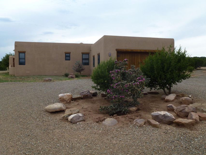 Not to be missed Hacienda style, one-of-a-kind Manzano Mountain home on 40 acres with expansive views located in Central New Mexico near the Cibola National Forest. Luxury touches throughout include custom made screen, entry door, oak hardwood and travertine stone floors, granite counter tops, Pella windows and doors with internal shades, 6-inch walls, and skip trowel plaster. Two of the bedrooms have French-door access to the courtyard and fountain. Kitchen has top-of-the-line appliances, alder cabinetry, features two granite apron sinks with dual disposals, and a northern view of Santa Fe's Sangre de Cristo Mountains. Eating bar seats four and separate dining room entertains eight comfortably.