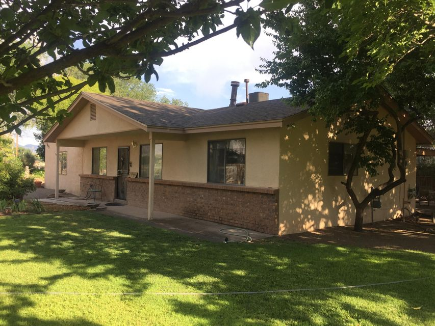Far north valley home nestled on a half acre with fruit trees, shade trees, roses and a koi pond. Enormous Metal Morgan building the size of a oversize one car garage. Storage buildings, chicken coop, garden area, grass, and a home that has ample space for all your needs.