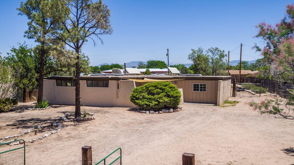 You'll love this charming ranch style home on a quiet street in Rio Communities. This 4 bedroom home has 2 living areas and a generous amount of space to move about at 1,992 square feet! On a large lot with spectacular views of the New Mexico sunrise and sunset. Has a wonderful fireplace to provide a cozy atmosphere. Included with all of this will be beautiful stainless steel appliances.