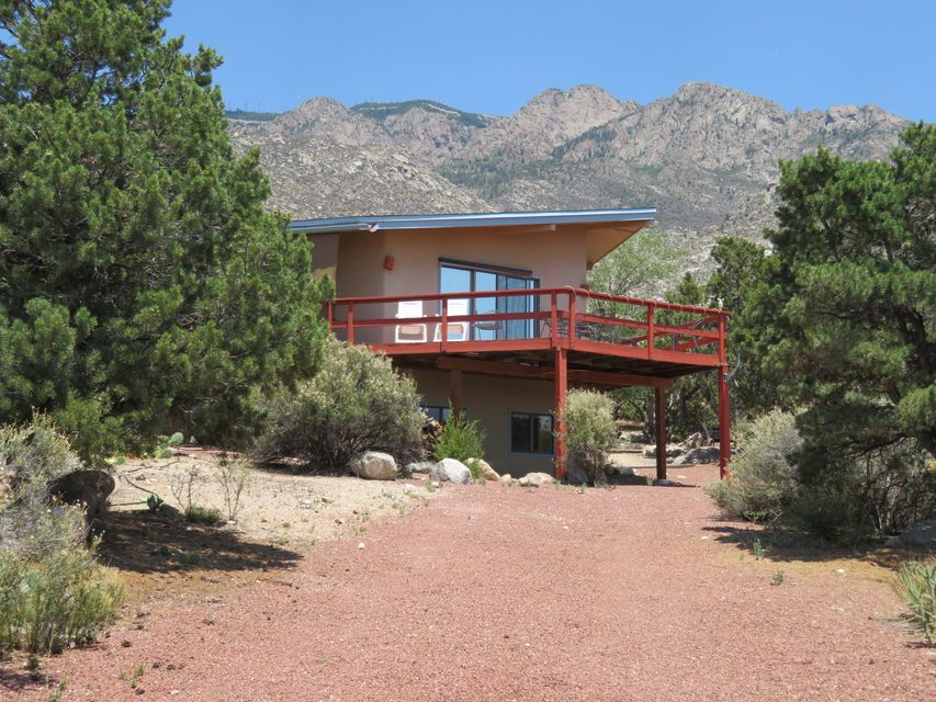 A MUST SEE HOME IN SANDIA HEIGHTSBEST VALUE FOR YOUR MONEY!Best views of the Mountain and City, you can watch the tram or the city lights while sitting in the hot Tub. large useable lot, large driveway with plenty of parking. home has had considerable upgrading with oak wood floors in the dining/great room. tankless water heater for endless hot water.  large rap-around deck. Mini-split in the great room for additional heating and cooling. 4th bedroom is very private with its own bathroom. new roof with 5 year transferable warranty.