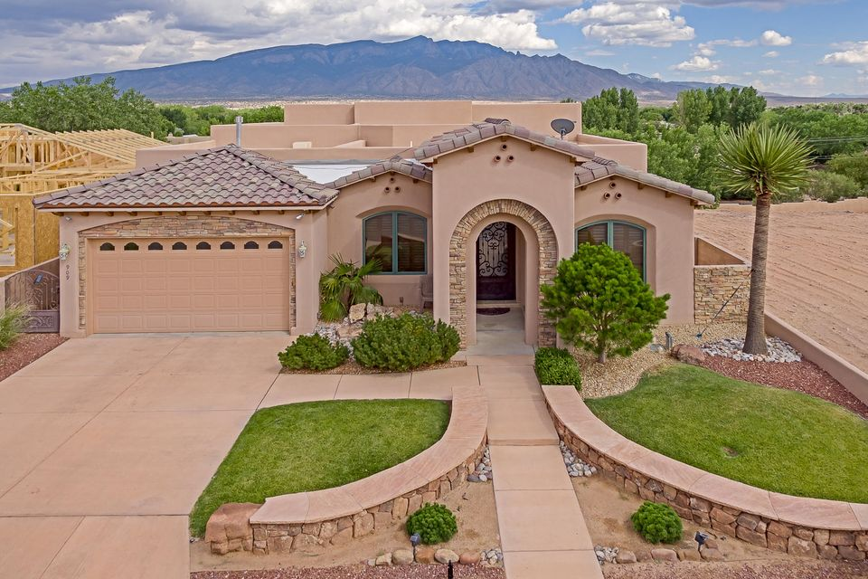 One level custom stunner in gated community with VIEWS. Excellent flow to this truly terrific home. Enter through the grand front door to the Foyer and be stunned by the Bosque and Mountain views.  Many Stunning features that include raised tongue & groove ceilings with large exposed vigas, diamond finish plaster interior walls, and a Kiva styled fireplace. The high end Chefs Kitchen includes hand carved cabinets, chiseled granite counters and top of the line stainless steel appliances. The large Master Suite has the second Kiva styled fireplace. The incredible Master Bath has a jetted tub, double vanity, a large walk thru double headed shower and a huge Closet. Enjoy the great outdoor patio with custom Gas Grill to take advantage of the wonderful views. Must see this home to appreciate!