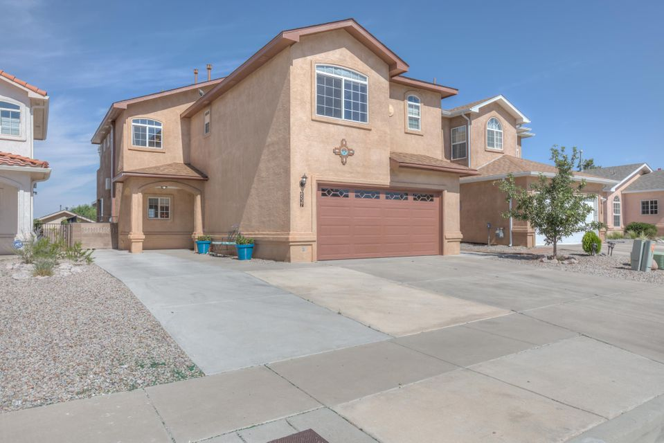 Pride of ownership! La Cueva, Desert Ridge, North Star, the trifecta of schools! 4 bedrooms, 2.5 baths, 2 car garage! Gleaming Hardwood floors throughout! All wet areas have tile, no carpet in this home. So many updates!Just to name a few... New Roof, 4/2018, new water heater 2/2018, fresh paint inside and out, new granite,stainless steel appliances, tile and garbage disposal in the kitchen 4/2018. Master bath remodel 4/2018. New light fixtures, and faucets. Wow, this is a must see property and move in ready. Did I mention it has refrigerated air? The dog park, soccer fields, and North Domingo park and multi-generational center are just steps away!Use the low maintenance back yard for entertaining and balloon watching. It's almost time for Balloon Fiesta, don't miss out!
