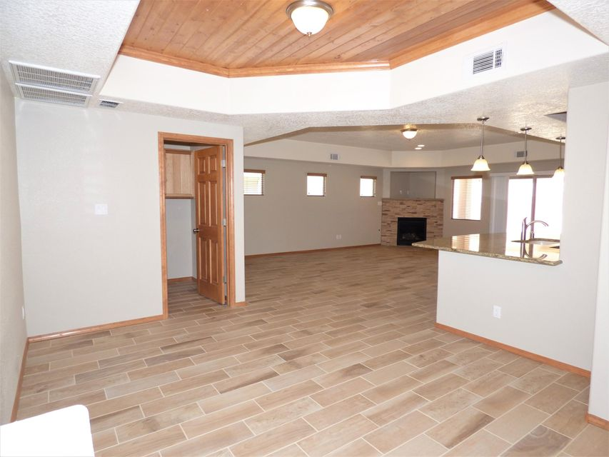 Fantastic New Construction Ready to move into. Beautiful Front & Back Landscaping on It's Way (Backyd is xeriscape upto Back Retaining Wall. Ask for Plan).  Wide Open Living Spaces, Pretty, Wood Look Tile Floor Thru-Out W/Exception to Carpet in the 3 Bedrms. Enjoy the Great Rm with it's Cozy Gas Log Fireplace that Opens to an Amazing Kitchen  W/Large Breakfast Bar/Island, Stainless Steel Appliances, Granite Countertops & Tons of Hickory Cabinets.The Master Suite Includes Dbl Vanity, Pretty Walk-In, Tiled Shower & there R 2 Closets. Ample Sized Secondary Bedrms W/Full Bath, Tile Floor & Granite Counter Tops. Dining Rm With it's T&G Ceiling Could be Sitting/Reading or Office. Huge Garage W/Extra Depth. Refrigerated Air, Low-E Windows, GREEN Built to Gold Level for Utility Savings & Comfort.