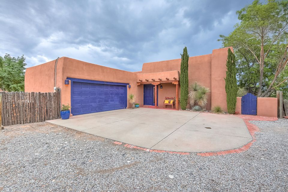 Rising above the surrounding properties,this custom pueblo provides breathtaking panorama views of mountains & city.Yes,an equestrian's dream,plus access to riding, walking & bike trails.Well designed for living, this gracious home has style!Great-room w/kiva FP,beamed high ceilings, bookshelves,adobe accents & views! Intimate formal dining,spacious gourmet kitchen w/personality,Viking Prof.gas stove & oven.Silestone counters,stainless steel appliances. Private MBR w/walk in closet,bath & access to courtyard.Recently installed high efficiency forced air cooling & heating system controlled by app on phone.Kinetico water RO and conditioner.Sits on 1.60 acres. Barnmaster 2 stall w/12X12 tack room and hay storage.Large turnout or arena! 3BR/2BA/XL 2 car garage with 220, and sink.Gated entry..