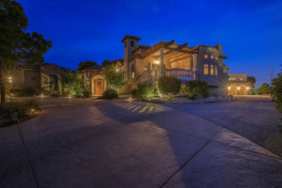 This ''One if a Kind'' Masterpiece located in an Exclusive North Albuquerque Acres gated community is ready for new ownership. As you enter the private entry of this home you immediately feel the love the owners have for this home. The 7569 sqft features 5-6 bedrooms/7 Bathrooms/Great Room/Game Room/Movie Theater/Formal Living Room/Office/Pool House with Steam Shower /Detached One Bedroom Casita (Featuring a Living Room-Kitchen-Bathroom-Laundry Room with an attached 2 Car Garage) Multiple View Decks/Covered Patio with Outdoor Kitchen/Covered and Heated Swimming Pool/an Attached 3-4 Car Garage with an Indoor Basket Ball Court/ Cathedral Ceilings/Custom Doors/''Spa Like'' Master Bath/Walk in Closets/ AMAZING MOUNTAIN VIEWS/and so much more I have to show you the rest....