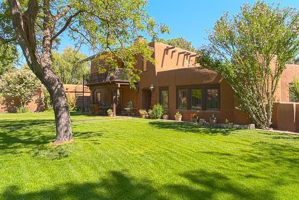 Beautifully maintained and gorgeous throughout. Santa Fe style adobe with brick and flagstone floors. Kiva fireplaces, upscale gourmet kitchen. Huge recreation room with hot tub and pool table. Gunite heated pool with auto cover. So much more.....Guest house/casita! The gardens are exquisite with two Koi ponds, barns, stables and greenhouse. A wonderful rare find! The main house has 3 bedrooms, the 4th is in the guest house.This is a luxury home for the discerning costumer.